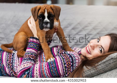Happy young woman  with a cute german boxer puppy - stock photo
