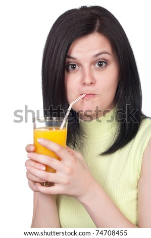 Happy young woman with a glass of refreshing oranges juice - isolated on white - stock photo
