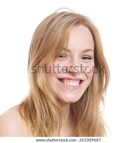 happy young woman with a infectous smile         - stock photo