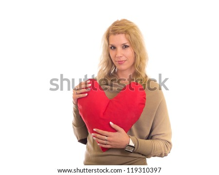 Happy young woman with big heart - stock photo