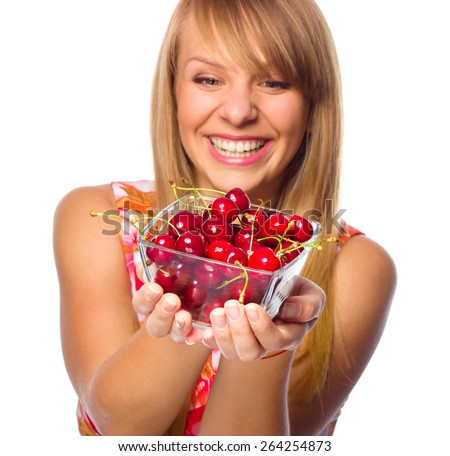 Happy young woman with cherries - stock photo