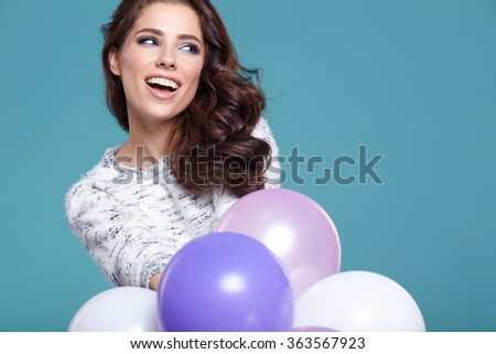 Happy young woman with colorful latex balloons, - stock photo