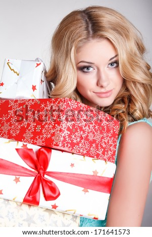 Happy young woman with gift boxes, birthday or Valentines Day party. Beautiful smiling girl with gift. Shopping sales.Joyful woman with presents. Isolated, studio, white background. - stock photo
