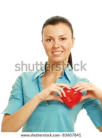 Happy young woman with heart love symbol  isolated on white background - stock photo