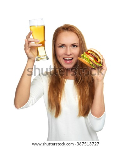 Happy young woman with lager beer mug and burger sandwich hamburger in hands hungry drinking isolated on a white background - stock photo