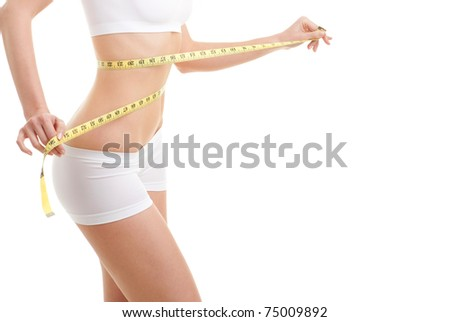 happy young woman with measure tape - stock photo