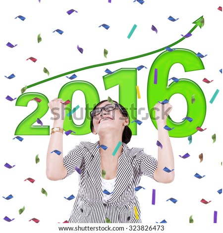 Happy young woman with numbers 2016 and upward arrow. New year concept - stock photo