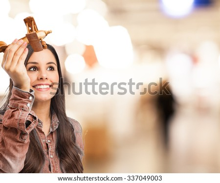 happy young woman with plane - stock photo
