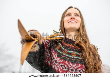 Happy young woman with retro ski outdoors portrait, focus on mouth - stock photo