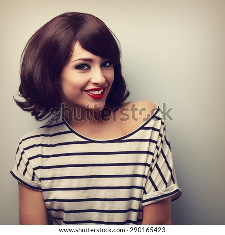 Happy young woman with short hairstyle toothy smiling. Vintage closeup portrait - stock photo