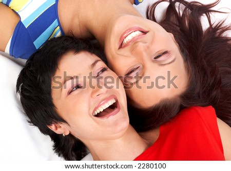 Happy young women friends talking and laughing. - stock photo