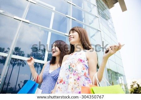 happy Young Women with Shopping Bags - stock photo