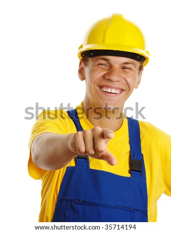Happy young worker pointing at you and smile, isolated over white - stock photo