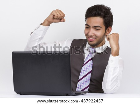 happyness businessman on a laptop cheers about something he sees - stock photo