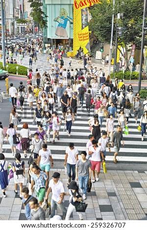 HARAJUKU, TOKYO - JULY 26, 2014: Pedestrian crossing in the corner of La Foret Harajuku fashion building and Tokyu Plaza shopping complex in Omotesando and Harajuku area, downtown Tokyo. - stock photo