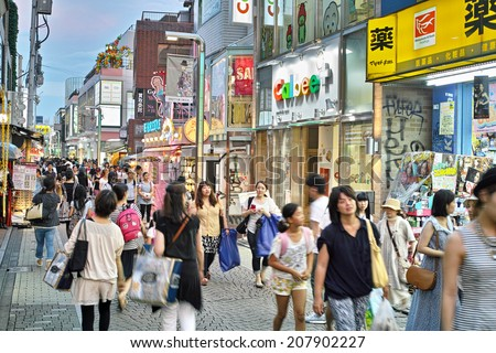 HARAJUKU, TOKYO - JULY 26, 2014: Takeshita Street, pedestrian street with many fashion boutiques, groceries, restaurants and cafes. Takeshita Dori is very popular among younger generations. - stock photo