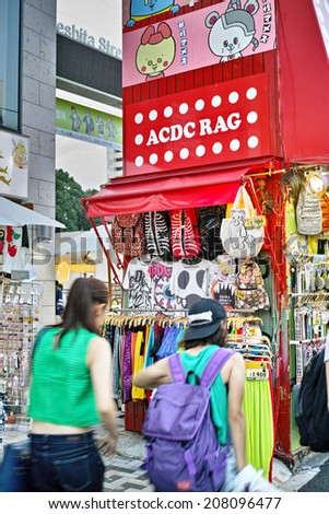 HARAJUKU, TOKYO - JULY 26, 2014: Takeshita Street, pedestrian street with many fashion boutiques, groceries, restaurants and cafes. Takeshita Dori is popular for younger generations. - stock photo