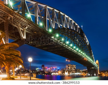 Harbor Bridge in Sydney during the night with city lights and dark sky - stock photo