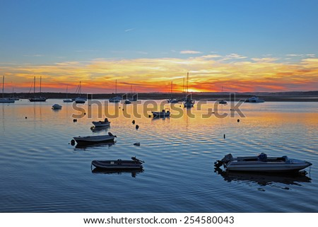 Harbor from Alvor in Portugal at sunset - stock photo