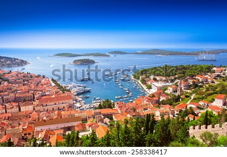Harbor of old Adriatic island town Hvar. High angle panoramic view. Popular touristic destination of Croatia. - stock photo