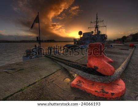 Harbor quayside sunset - stock photo