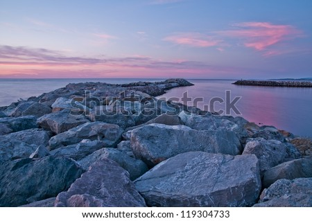 Harbor reflections in pink and blue - stock photo