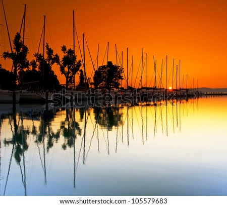 Harbor with sunset in Hungary - stock photo