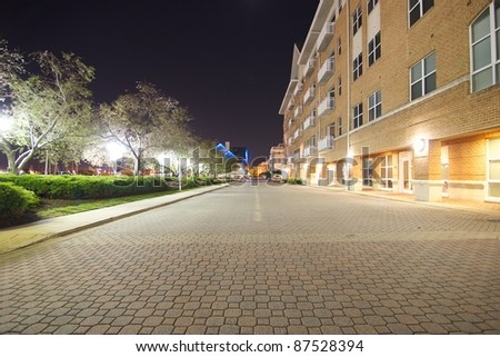 Harborview Homes Apartments Walkway at Night Lit Up in Baltimore Maryland - stock photo