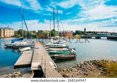 Harbour And Quay Yacht Stand At Pier, Jetty In Summer Day - stock photo