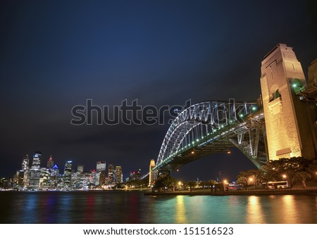 harbour bridge and skyline of sydney in australia at night - stock photo
