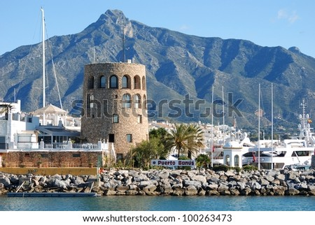 Harbour entrance with the watchtower to the left and La Concha mountain to the rear, Puerto Banus, Marbella, Costa del Sol, Malaga Province, Andalusia, Spain, Western Europe. - stock photo