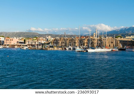 harbour of Chania with historical houses and boats at sunny summer day, Crete, Greece - stock photo