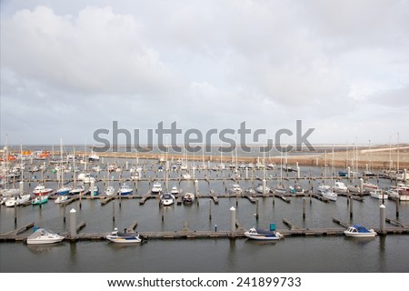 harbour with yachts at IJmuiden in the netherlands in winter time - stock photo