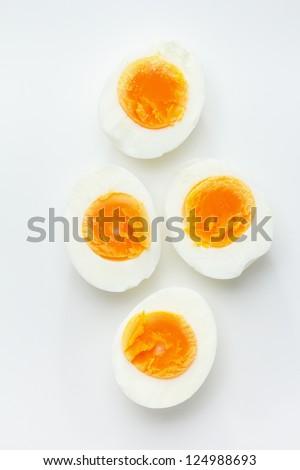 Hard boiled egg halves - stock photo