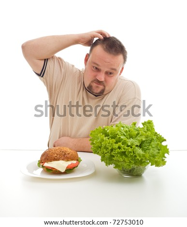 Hard diet choices concept with overweight man scratching his head - healthy or unhealthy - stock photo