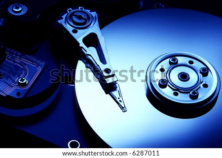 Hard disk detail with a blue hue to accentuate the coldness of technology - stock photo