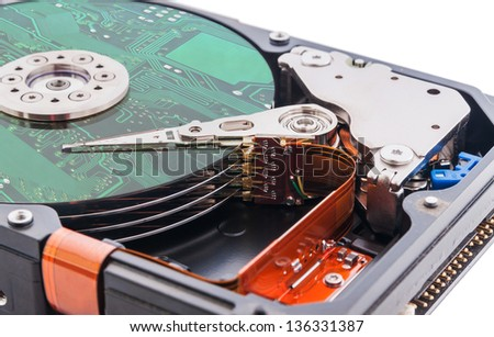 Hard disk drive and circuit board on it's surface. - stock photo