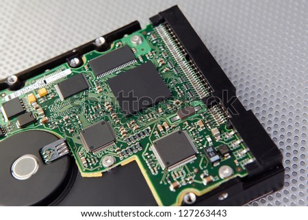 Hard disk drive and electronic circuit board with interesting technology background - stock photo
