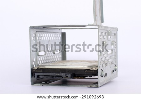Hard disk drive (HDD) of the computer in the block on the white background - stock photo
