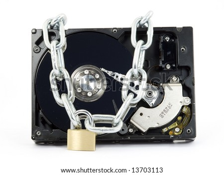 hard disk drive locked in chains isolated - stock photo