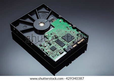 Hard disk drive on a reflective background - stock photo