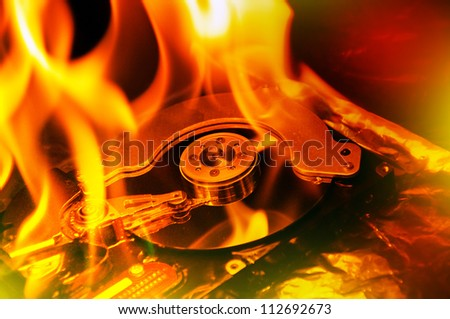 Hard disk failure. Computer hard disk on fire, burning in flames. Data loss concept, computer crash. - stock photo
