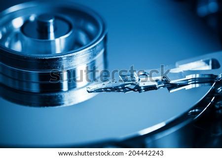 hard disk inside closeup ,computer data concept background  - stock photo