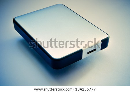 hard disk on a blue background closeup - stock photo