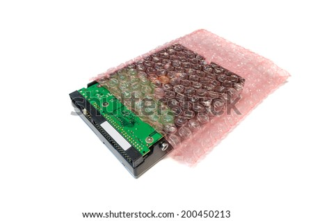 Hard disk storage with air bubble roll on a white background. - stock photo