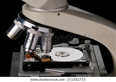 Hard Disk under a Microscope - stock photo