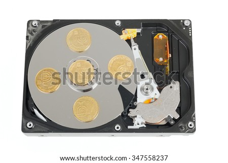 Hard disk without cover with israeli coins isolated on white background - stock photo