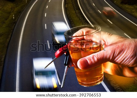 hard drinker with liqueur glass and going cars - stock photo