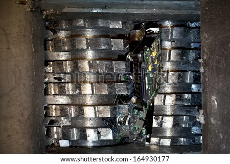 Hard drive crusher shredder used for sensitive data destruction or electronic / media destruction. - stock photo
