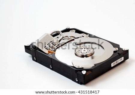 Hard drive disk and combination lock padlock. Data security concept. - stock photo